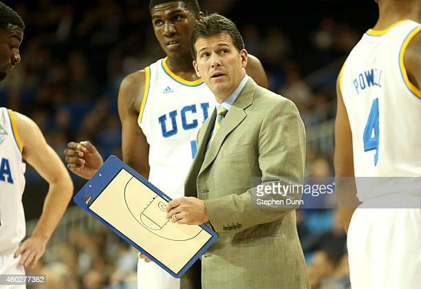 Head coach Steve Alford of the UCLA Bruins talks to his team during a timeout against the UC Riverside Highlanders at Pauley Pavilion on December 10...