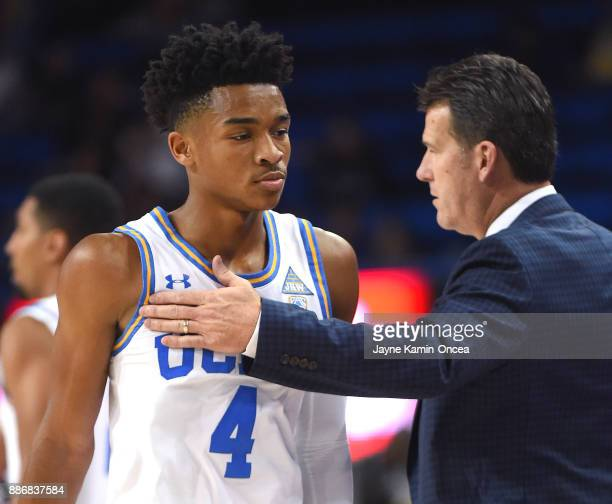 Head coach Steve Alford of the UCLA Bruins talks to Jalen Hands during a time out in the game against the Detroit Mercy Titans at Pauley Pavilion on...
