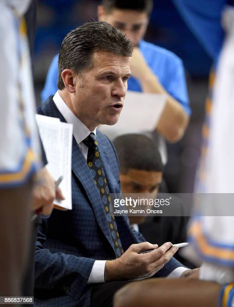 Head coach Steve Alford of the UCLA Bruins talks to the team during a time out in the game against the Detroit Mercy Titans at Pauley Pavilion on...