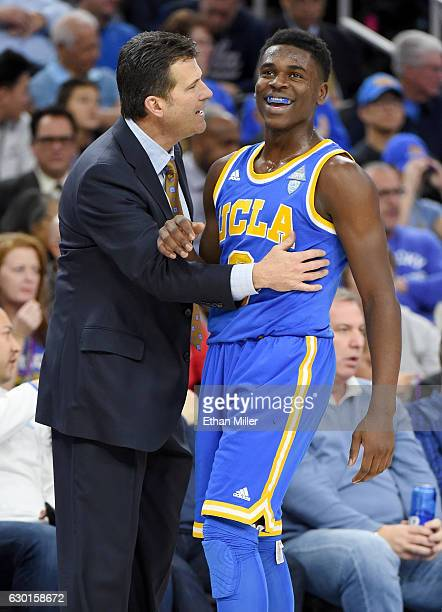 Head coach Steve Alford of the UCLA Bruins talks with Aaron Holiday during their game against the Ohio State Buckeyes during the CBS Sports Classic...