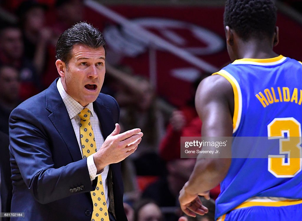 Head coach Steve Alford of the UCLA Bruins talks with his player Aaron Holiday #3 in the first half of the Bruins 83-82 win over the Utah Utes at the Jon M. Huntsman Center on January 14, 2017 in Salt Lake City, Utah.