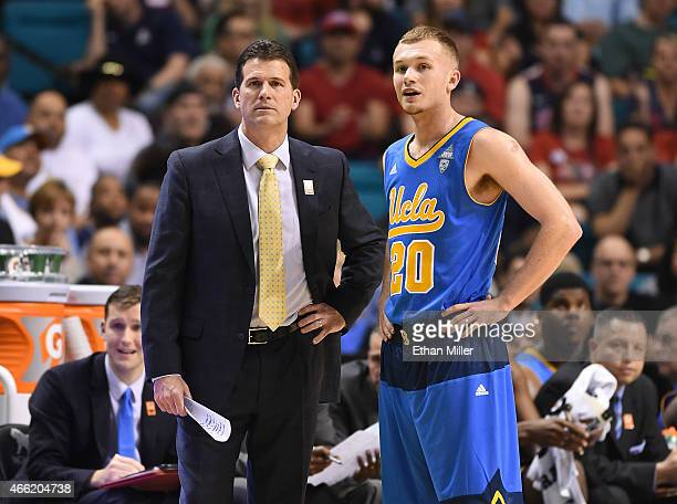 Head coach Steve Alford of the UCLA Bruins talks with his son Bryce Alford during a semifinal game of the Pac12 Basketball Tournament against the...