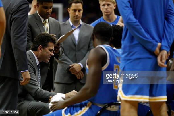 Head coach Steve Alford of the UCLA Bruins talks with players during a timeout in the National Collegiate Basketball Hall Of Fame Classic game...