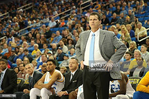 Head coach Steve Alford of the UCLA Bruins watches courtside as the UCLA Bruins take on the Long Beach State 49ers at Pauley Pavilion on December 6...