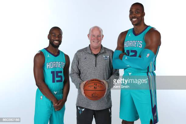 Head coach Steve Clifford Kemba Walker and Dwight Howard of the Charlotte Hornets pose for a portrait during media day on September 25 2017 at...