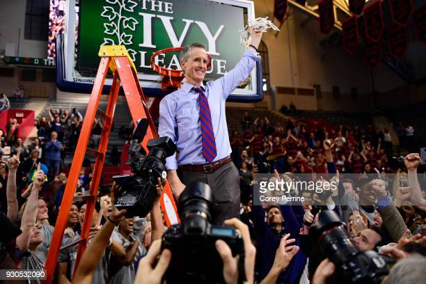 Head coach Steve Donahue of the Pennsylvania Quakers holds up the net after the win of the Men's Ivy League Championship Tournament at The Palestra...