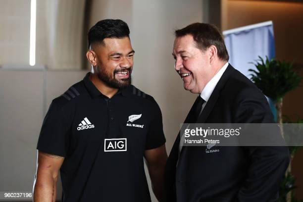 Head coach Steve Hansen of the All Blacks congratulates Jordan Taufua after being named in the New Zealand All Blacks squad following the team...