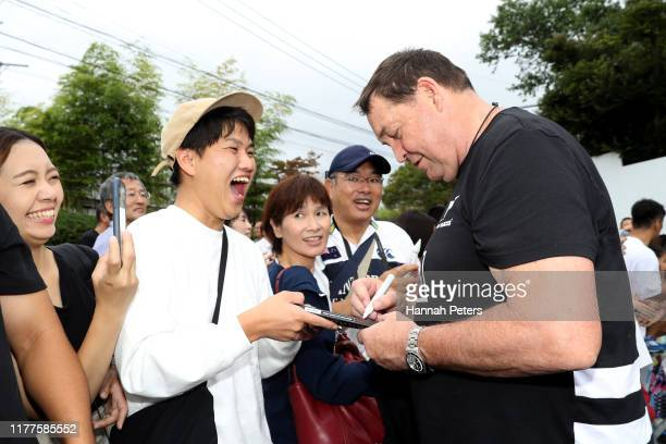 Head coach Steve Hansen of the All Blacks signs autographs following a New Zealand training session at Jissoji Tamokuteki Ground on September 28,...
