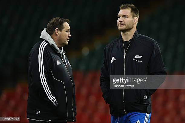 Head coach Steve Hansen of the All Blacks talks to Ali Williams during a captain's run at Millennium Stadium on November 23 2012 in Cardiff Wales