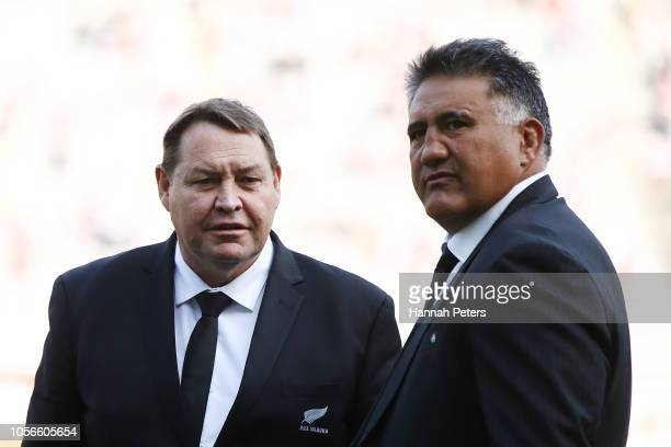 Head coach Steve Hansen of the All Blacks talks with head coach Jamie Joseph of Japan ahead of the test match between Japan and New Zealand All...