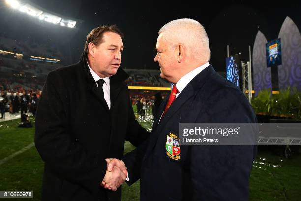 Head coach Steve Hansen shakes hands with head coach Warren Gatland of the Lions the Test match between the New Zealand All Blacks and the British &...