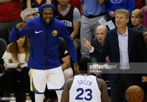 Head coach Steve Kerr Kevin Durant and Draymond Green of the Golden State Warriors react in the fourth quarter of Game Seven of the Western...