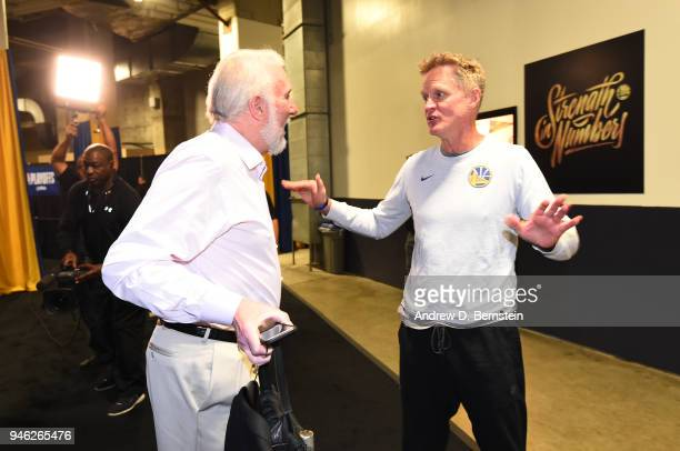 Head Coach Steve Kerr of the Golden State Warriors and Head Coach Gregg Popovich of the San Antonio Spurs speak before the game in Game One of Round...