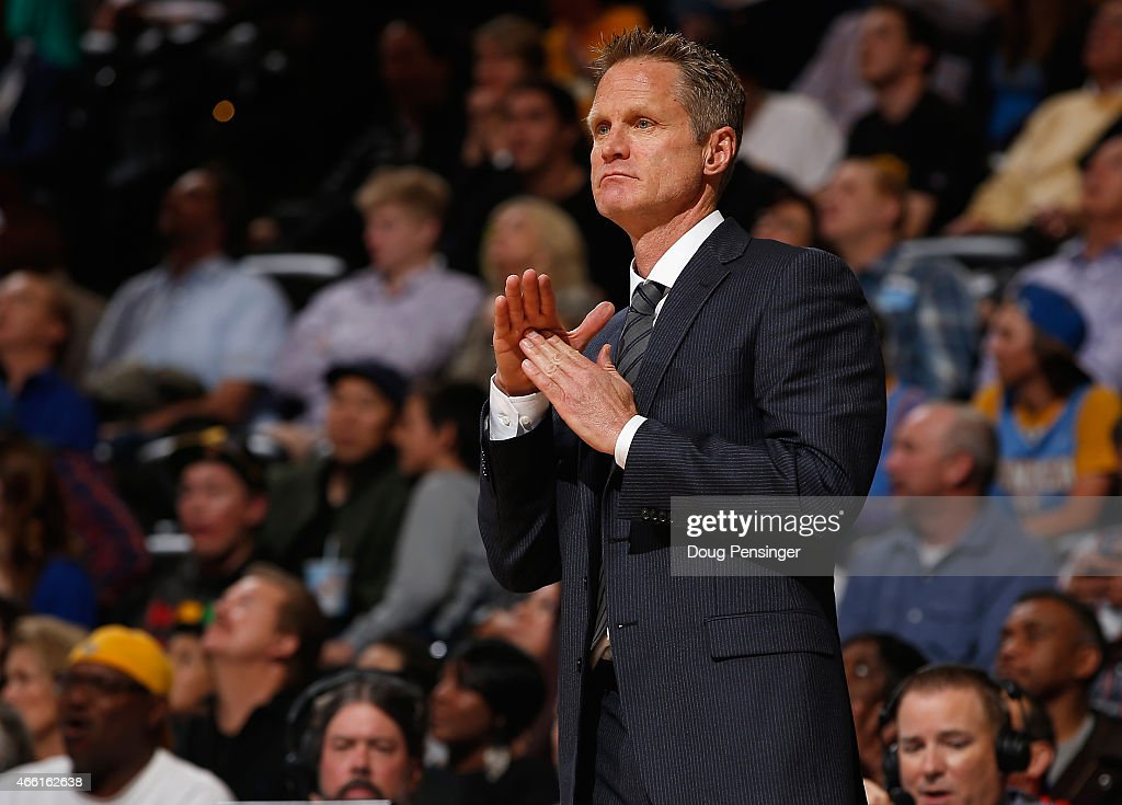 Head coach Steve Kerr of the Golden State Warriors calls a timeout against the Denver Nuggets at Pepsi Center on March 13, 2015 in Denver, Colorado. The Nuggets defeated the Warriors 114-103.