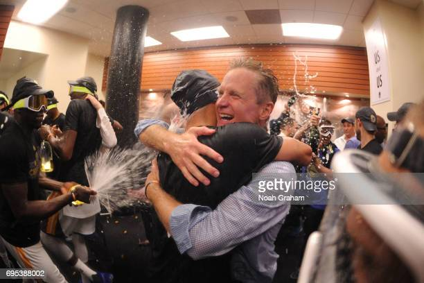 Head Coach Steve Kerr of the Golden State Warriors celebrates in the locker room after defeating the Cleveland Cavaliers in Game Five of the 2017 NBA...