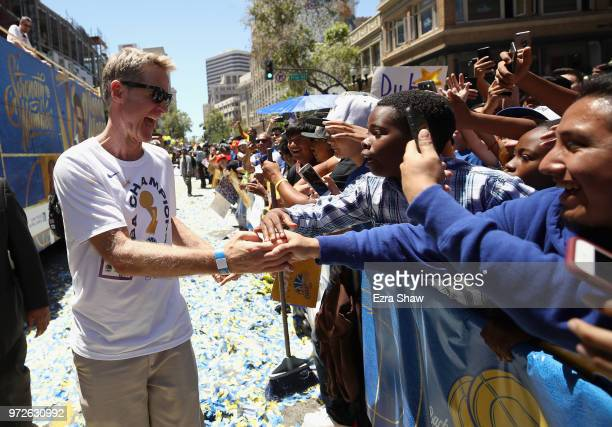 Head coach Steve Kerr of the Golden State Warriors celebrates with the crowd during the Golden State Warriors Victory Parade on June 12 2018 in...