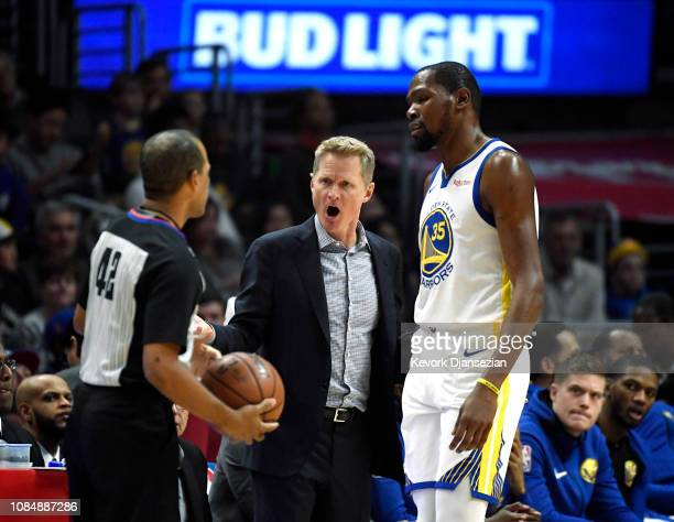 Head coach Steve Kerr of the Golden State Warriors complains to referee Eric Lewis after a foul call as Kevin Durant of the Golden State Warriors...