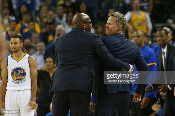 Head coach Steve Kerr of the Golden State Warriors is held back by assistant coach Mike Brown after Kerr received a Technical Foul in the game...