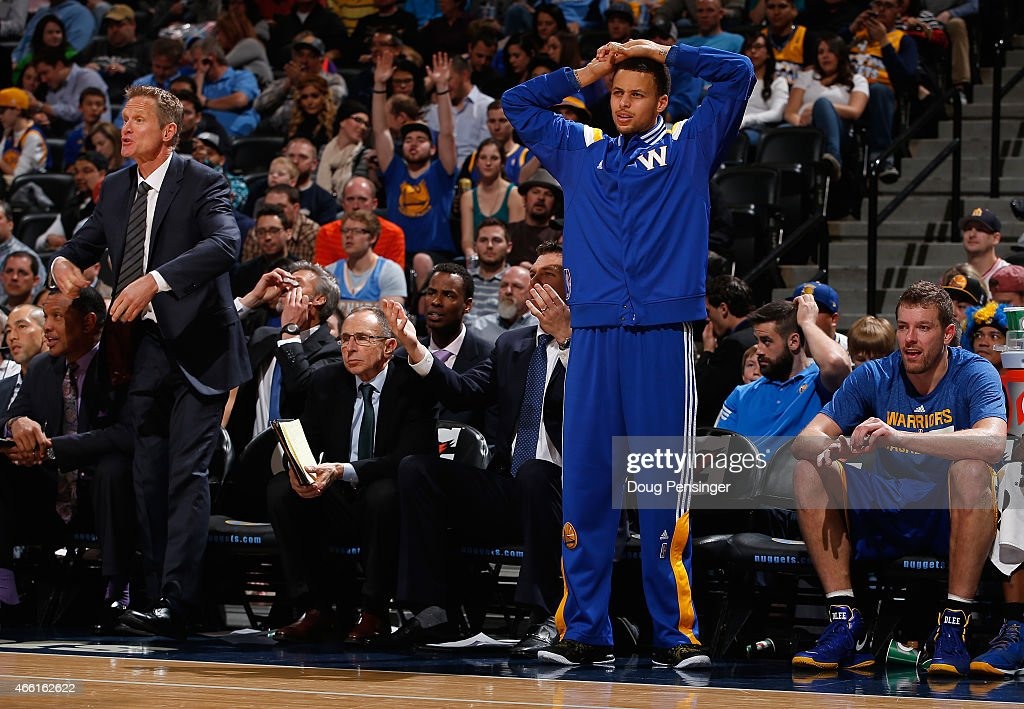 Head coach Steve Kerr of the Golden State Warriors leads his team as Stephen Curry #30 of the Golden State Warriors reacts to a call as they face the Denver Nuggets at Pepsi Center on March 13, 2015 in Denver, Colorado. The Nuggets defeated the Warriors 114-103.
