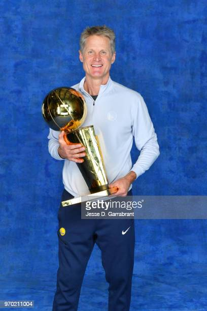 Head Coach Steve Kerr of the Golden State Warriors poses for a portrait with the Larry O'Brien Championship trophy after defeating the Cleveland...