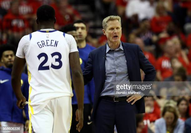 Head coach Steve Kerr of the Golden State Warriors reacts in the first half as Draymond Green walks to the bench against the Houston Rockets in Game...
