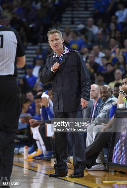 Head coach Steve Kerr of the Golden State Warriors reacts to the action on the court against the Washington Wizards during an NBA basketball game at...