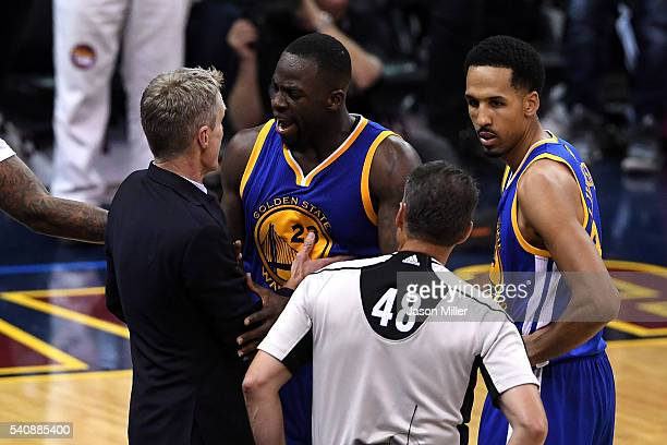 Head coach Steve Kerr of the Golden State Warriors reacts with Draymond Green and Shaun Livingston as referee Scott Foster looks on in the second...