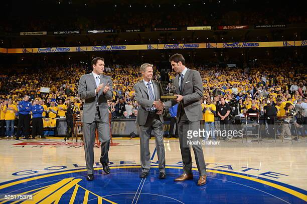 Head coach Steve Kerr of the Golden State Warriors receives the Red Auerbach Trophy as the 201516 NBA Coach of the Year from Assistant Coach Luke...