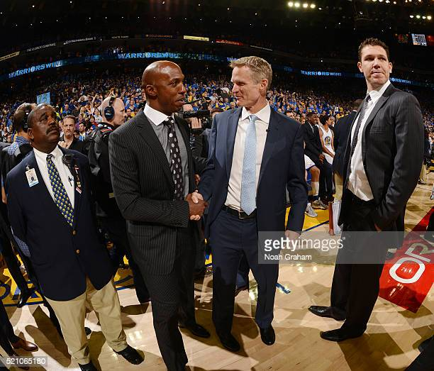 Head coach Steve Kerr of the Golden State Warriors shakes hands with Chauncey Billups after the game against the Memphis Grizzlies on April 13 2016...