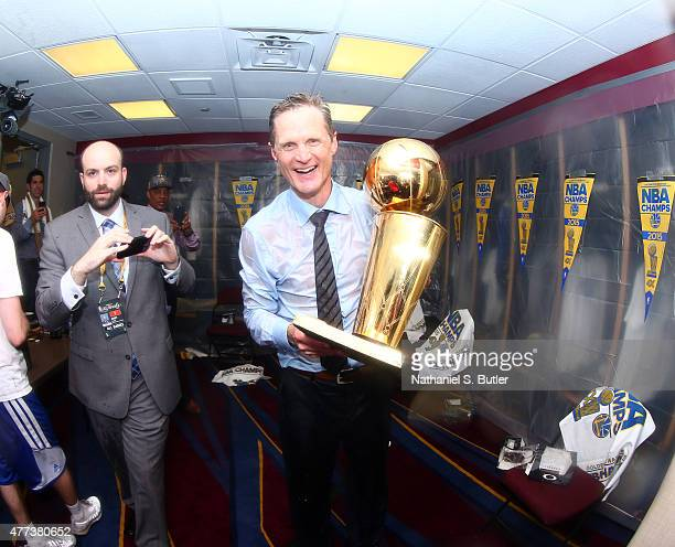 Head Coach Steve Kerr of the Golden State Warriors smiles in the locker room with the Larry O'Brien Championship Trophy after the Golden State...