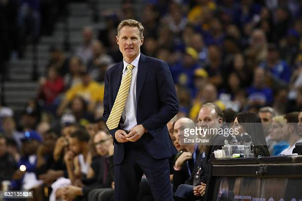 Head coach Steve Kerr of the Golden State Warriors stands on the side of the court during their game against the Cleveland Cavaliers at ORACLE Arena...