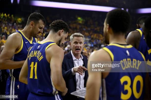 Head coach Steve Kerr of the Golden State Warriors talks to his team before playing against the LA Clippers in Game Five of the first round of the...