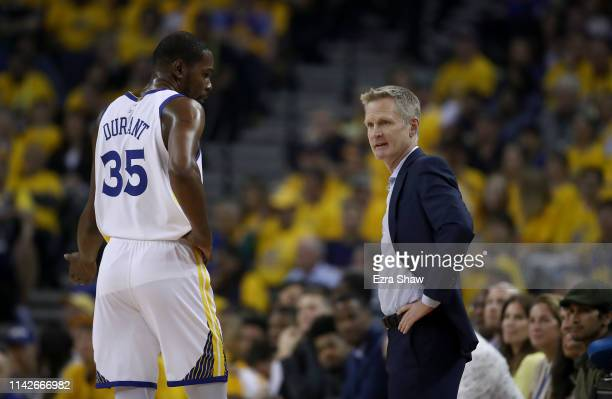Head coach Steve Kerr of the Golden State Warriors talks to Kevin Durant during their game against the LA Clippers during Game One of the first round...