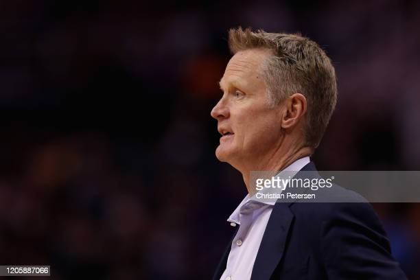 Head coach Steve Kerr of the Golden State Warriors watches from the bench during the first half of the NBA game against the Phoenix Suns at Talking...