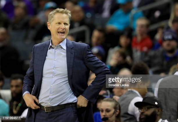 Head coach Steve Kerr of the Golden State Warriors watches on against the Charlotte Hornets during their game at Spectrum Center on December 04 2019...