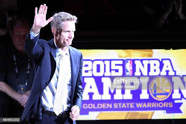 Head coach Steve Kerr of the Golden State Warriors waves to the crowd during the championship ring ceremony prior to their NBA season opener against...