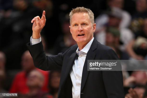 Head coach Steve Kerr of the Golden State Warriors works the sidelines against the Denver Nuggets in the fourth quarter at the Pepsi Center on March...