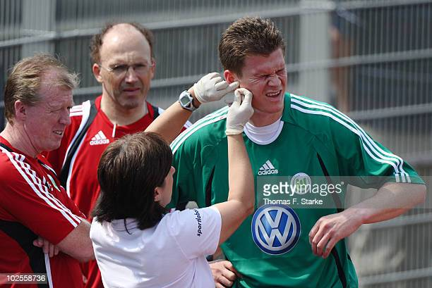 Head coach Steve McClaren and assistant coach Achim Sarstedt look on while Alexander Madlung is poked in his ear during the VfL Wolfsburg training...