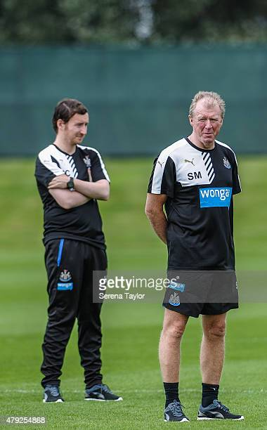 Head Coach Steve McClaren and Assistant Coach Ian Cathro stand on the pitch during the Newcastle United PreSeason Training session at The Newcastle...