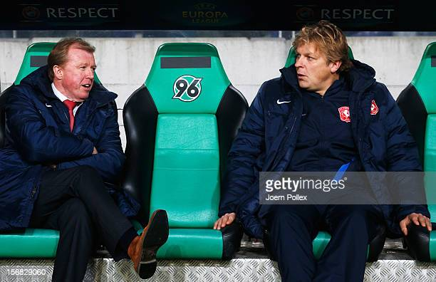Head coach Steve McClaren and assistant coach Youri Mulder of Twente chat prior to the UEFA Europa League Group L match between Hannover 96 and FC...