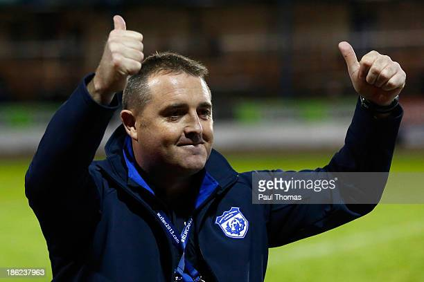 Head coach Steve McCormack of Scotland celebrates after the Rugby League World Cup Group C match between Tonga and Scotland at Derwent Park on...