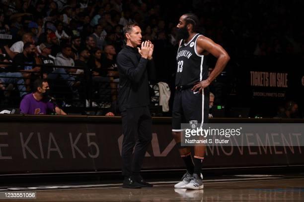 Head Coach Steve Nash of the Brooklyn Nets talks to James Harden of the Brooklyn Nets during the game against the Milwaukee Bucks during Round 2,...