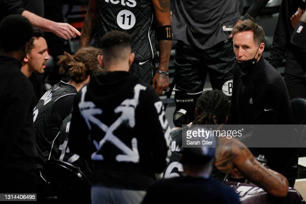 Head coach Steve Nash of the Brooklyn Nets talks with his team during a timeout during the second half against the Phoenix Suns at Barclays Center on...