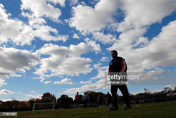 Head Coach Steve Nicol of the New England Revolution leads his team off the pitch after a practice session for the upcoming MLS Cup at RFK Stadium...