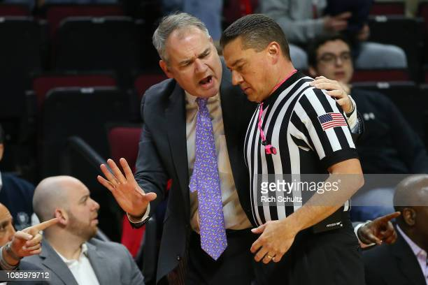 Head coach Steve Pikiell of the Rutgers Scarlet Knights argues a foul with an official during the first half of a game against the Nebraska...