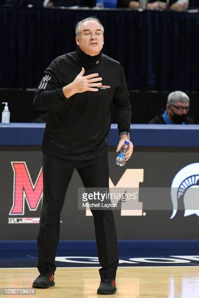 Head coach Steve Pikiell of the Rutgers Scarlet Knights signals to his players during the first half of a college basketball game against the Penn...