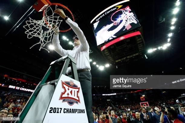Head coach Steve Prohm of the Iowa State Cyclones cuts down the net after defeating the West Virginia Mountaineers to win the championship game of...