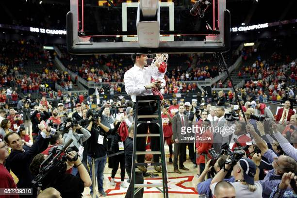 Head coach Steve Prohm of the Iowa State Cyclones cuts down the net along with son Cass after defeating the West Virginia Mountaineers to win the...
