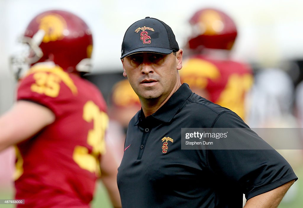 Head coach Steve Sarkisian of the USC Trojans watches his team during warmups for the game with the Idaho Vandals at Los Angeles Memorial Coliseum on September 12, 2015 in Los Angeles, California.