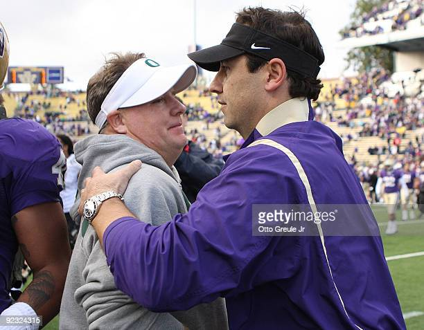 Head coach Steve Sarkisian of the Washington Huskies congratulates head coach Chip Kelly of the Oregon Ducks after the game on October 24, 2009 at...